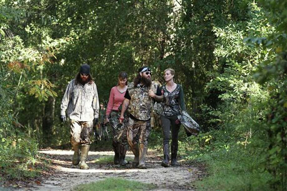 "This 2013 photo released by A&E Network shows, from left, Jase Robertson, Missy Robertson, Willie Robertson and Korie Robertson, in the episode ""Let's Go Hunting, Deer,"" from the A&E Networks show, ""Duck Dynasty."" The series star Willie Robertson will talk about his outspoken father, Phil Robertson, as he helps Fox News Channel ring in the new year. The network says Robertson and wife, Korie, will be guests on the ""All-American New Year"" special Fox News is airing Tuesday night, Dec. 31, 2013. (AP Photo/A&E Network, Art Streiber) Photo: Art Streiber / A&E Network"