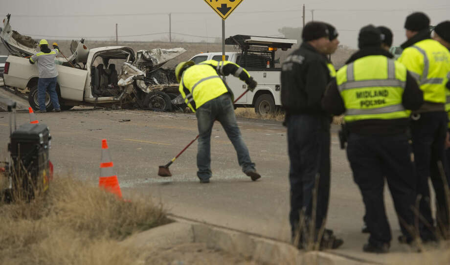 Crews work to remove vehicles from the access road along I-20 in front of the Horseshoe Arena Monday 01-18-16 morning following a two vehicle accident that resulted in one fatality. Tim Fischer/Reporter-Telegram Photo: Tim Fischer