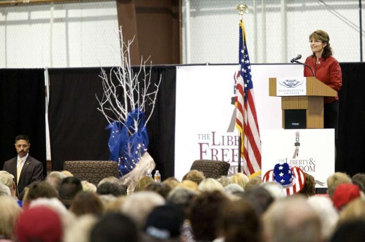 (2010 File Photo) Sarah Palin speaks to a crowd of 1,000 who bought tickets for the early afternoon event sponsored by the Liberty and Freedom Foundation of New York at the CAF Hangar in 2010.