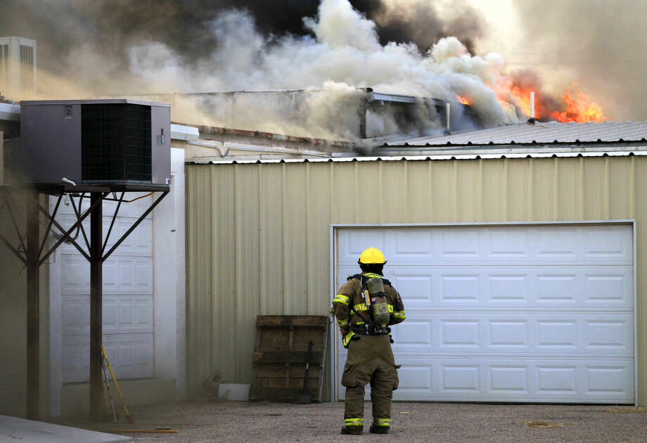 Midland emergency personnel work the scene of a fire at a storage building north of the intersection of Midkiff and Wall Street, Friday Jan. 9, 2015. James Durbin/Reporter-Telegram Photo: James Durbin