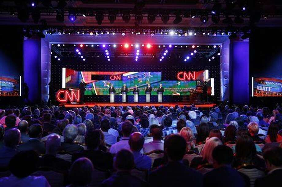 Democratic presidential candidates from left, former Virginia Sen. Jim Webb, Sen. Bernie Sanders, of Vermont, Hillary Rodham Clinton, former Maryland Gov. Martin O'Malley, and former Rhode Island Gov. Lincoln Chafee stand on stage during the CNN Democratic presidential debate Tuesday, Oct. 13, 2015, in Las Vegas. (AP Photo/John Locher) Photo: John Locher