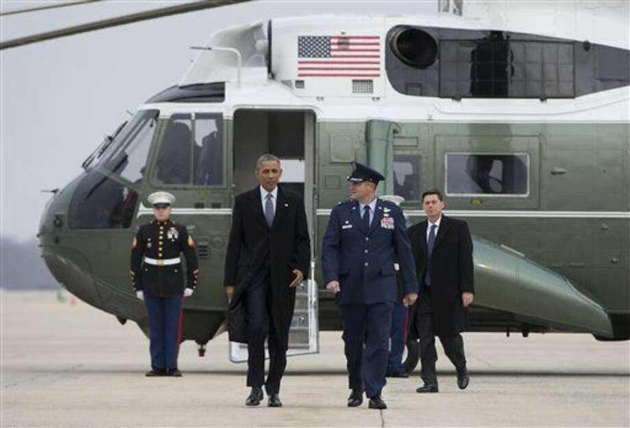 President Barack Obama walks from Marine One to board Air Force One, Wednesday, Jan. 21, 2015, at Andrews Air Force Base, Md., en route to Boise State University where he will discuss the themes in his State of the Union address. (AP Photo/Carolyn Kaster) Photo: Carolyn Kaster
