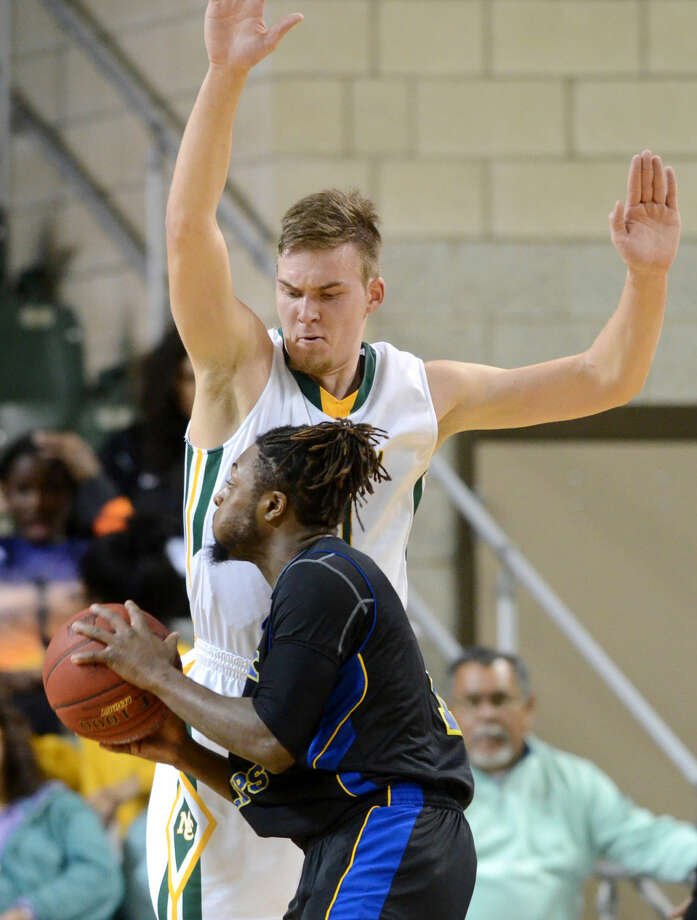Midland College's Norbertus Giga (20) covers Frank Phillips College's Lucious McKay (1) on Thursday, Jan. 14, 2016, at Chaparral Center. James Durbin/Reporter-Telegram Photo: James Durbin