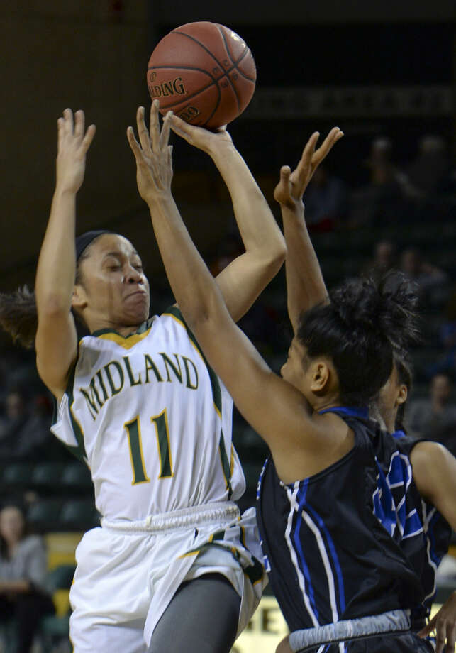 Midland College's Sierra Dixon drives the lane as Salt Lake's Ma'ata Epenisa defends Saturday 11-21-2015 in the championship game of the 6th annual Women's NIT at MC. Tim Fischer\Reporter-Telegram Photo: Tim Fischer