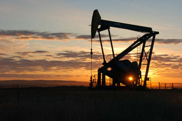 A Whiting Petroleum Co. pump jack pulls crude oil from the Bakken region of the Northern Plains near Bainville, Mont. on Nov. 6, 2013. A sharp rise in domestic oil production from the Bakken and other parts of the U.S. has led to a dramatic increase in crude shipments by rail due to limited pipeline capacity. (AP Photo/Matthew Brown)