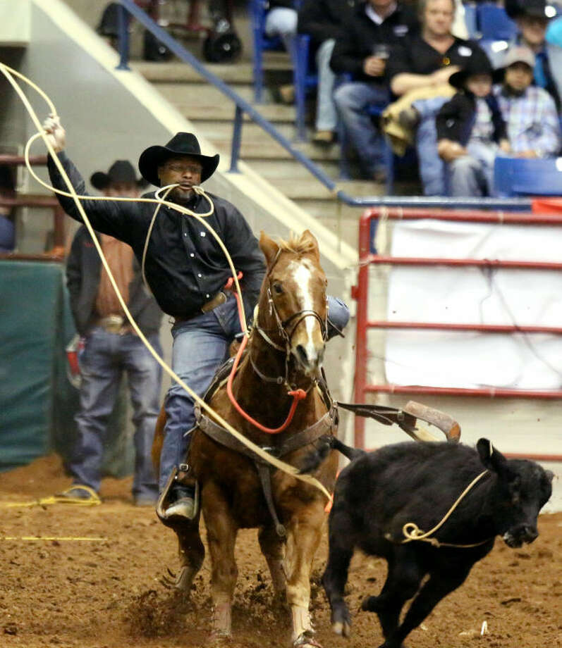 Cedric Martin catches a calf during the tie down roping competition on the second night of the SandHills Stock Show and Rodeo Saturday at the Ector County Coliseum. Photo: Edyta Blaszczyk | Odessa American