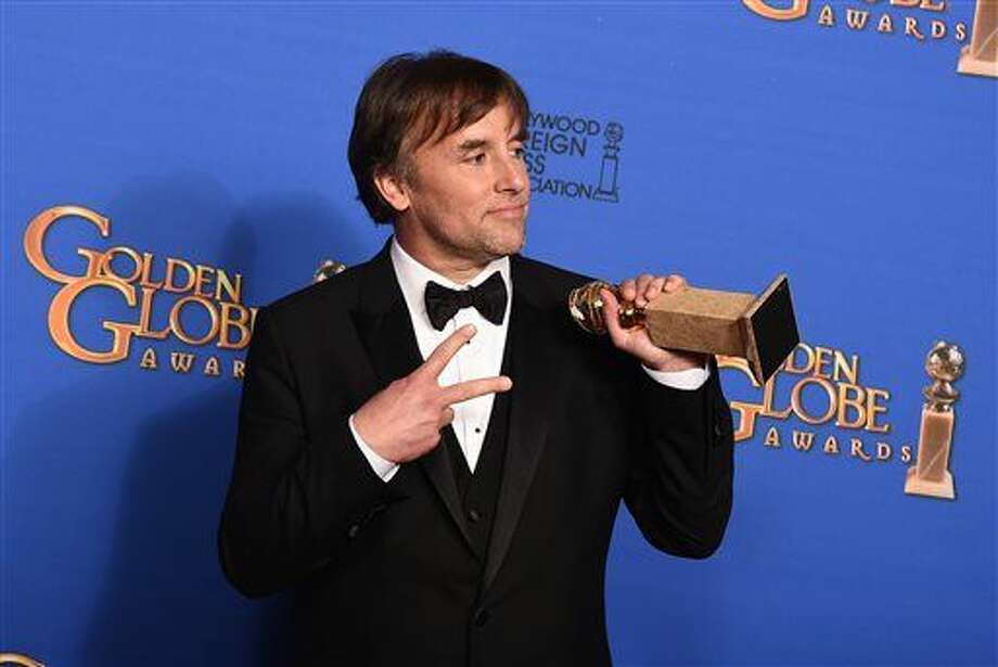 "Richard Linklater poses in the press room with the award for best director for ""Boyhood"" at the 72nd annual Golden Globe Awards at the Beverly Hilton Hotel on Sunday, Jan. 11, 2015, in Beverly Hills, Calif. (Photo by Jordan Strauss/Invision/AP) Photo: Jordan Strauss"