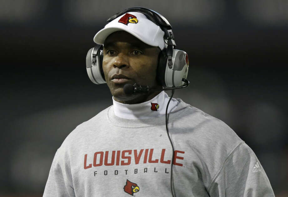 Louisville head coach Charlie Strong watches from the sidelines in the first half of his team's game against Cincinnati, Thursday, Dec. 5, 2013, in Cincinnati. (AP Photo/Al Behrman) Photo: Al Behrman