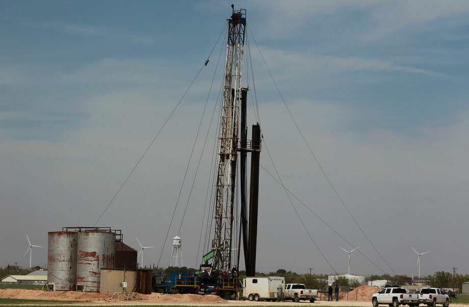 Drilling continues at a rig in Stanton, Texas where rigs and pumpjacks are a common sight. Drilling and petroleum related work continues to be the mainstay of economic development in the Permian Basin area. Photo: JOHN DAVENPORT