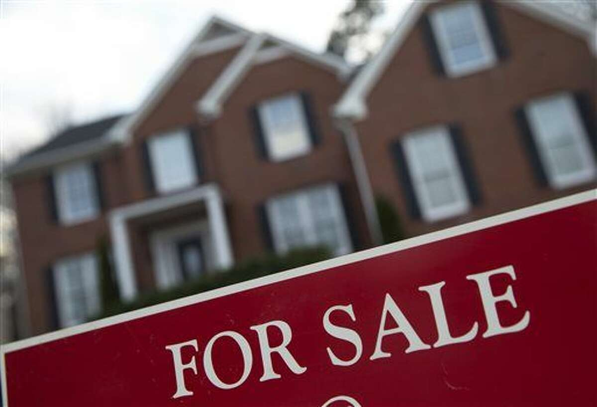 In this Thursday, Dec. 3, 2015, photo, an existing home for sale is shown in Roswell, Ga. The National Association of Realtors reports on December sales of existing homes, on Friday, Jan. 22, 2016. (AP Photo/John Bazemore)