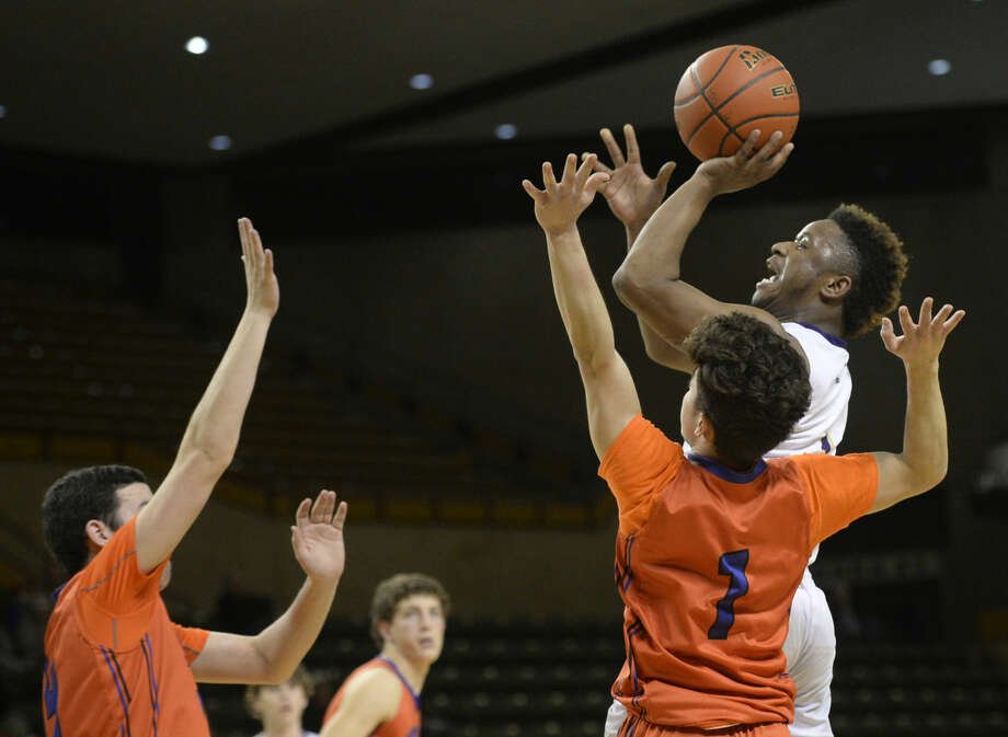 Midland High's Shawn Rivers (1) goes up for a shot against San Angelo Central on Friday, Jan. 22, 2016, at Chaparral Center. James Durbin/Reporter-Telegram Photo: James Durbin