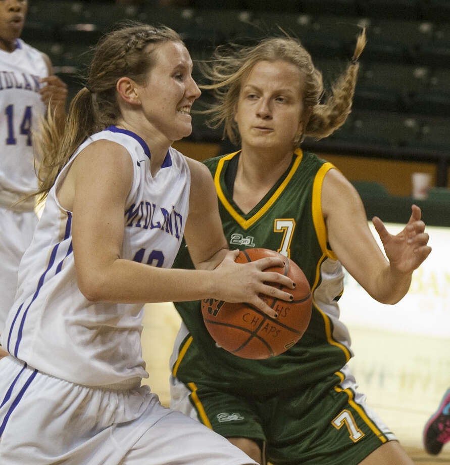 12-29-14 Midland High's Aubrie Elliot drives to the basket as Aussie Travellers' Naomi Smith defends Moday at the Byron Johnston Holiday Classic at the Chaparral Center. Tim Fischer\Reporter-Telegram Photo: Tim Fischer