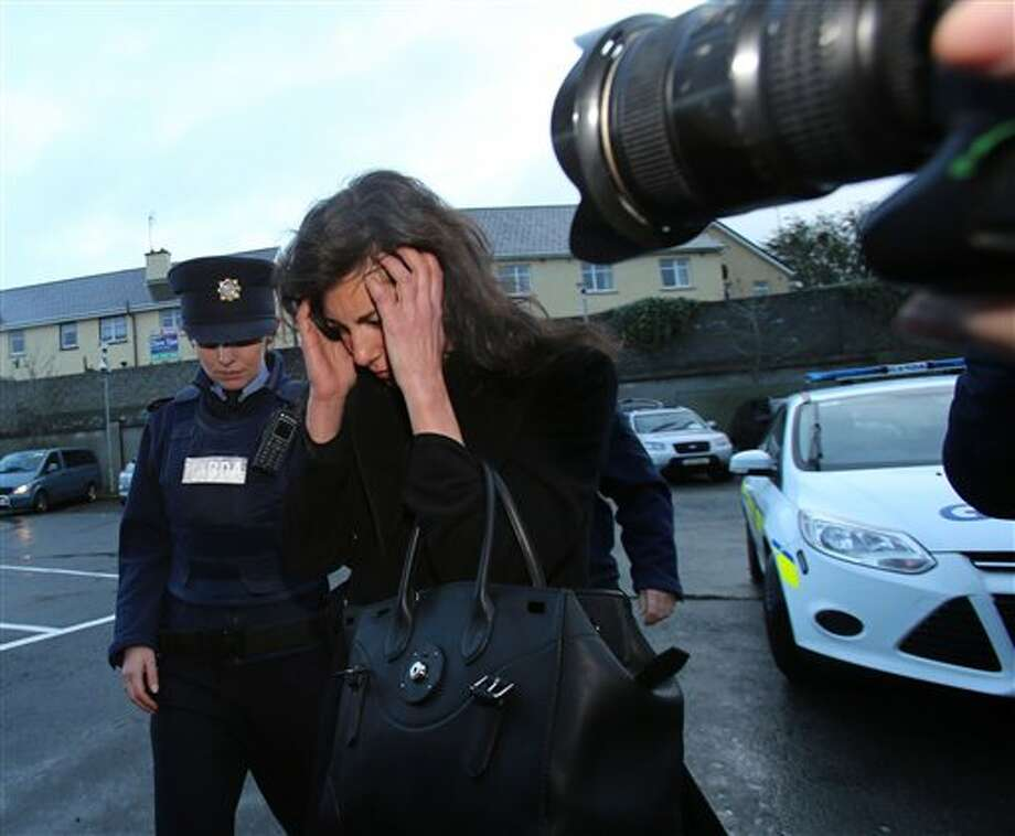 Jenny Lauren, centre, Niece of fashion designer Ralph Lauren, arrives at Killaloe District Court, in Killaloe, Ireland, Tuesday, Jan. 7, 2014. The niece of fashion designer Ralph Lauren has appeared in an Irish court on charges of being drunk and disorderly on a New York-bound plane. Jewelry designer Jenny Lauren was arrested after a Delta flight from Barcelona made an unscheduled stop at Shannon Airport on Monday. (AP Photo/PA, Niall Carson) UNITED KINGDOM OUT NO SALES NO ARCHIVE Photo: Niall Carson / PA