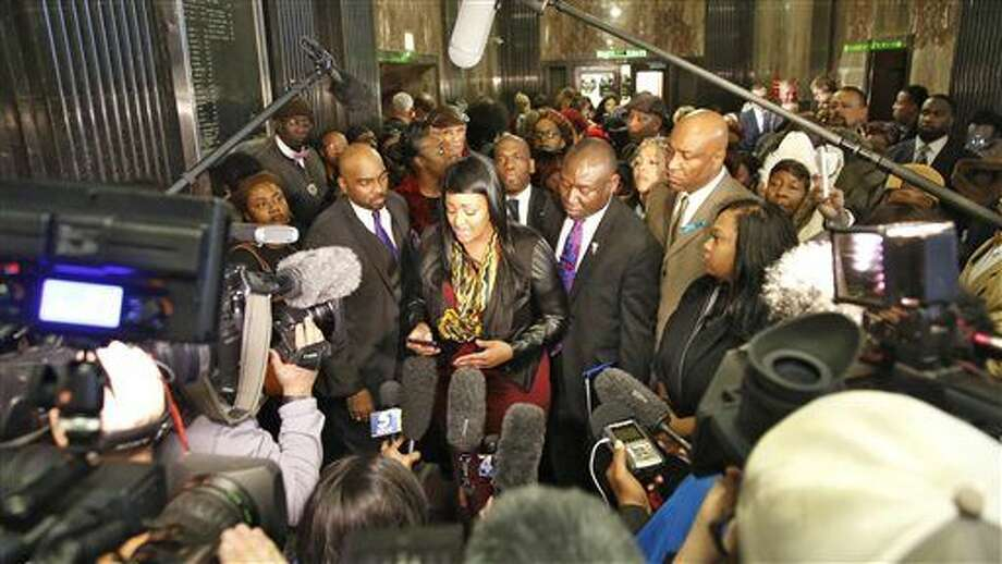 Shardayreon Hill, center, a victim of former Oklahoma City police officer Daniel Holtzclaw, speaks to members of the media at the Oklahoma County Courthouse after his sentencing, Thursday, Jan. 21, 2016, in Oklahoma City. Holtzclaw, convicted of raping and sexually victimizing eight women on his beat, was sentenced Thursday to 263 years in prison. (Steve Gooch/The Oklahoman via AP) LOCAL STATIONS OUT (KFOR, KOCO, KWTV, KOKH, KAUT OUT); LOCAL WEBSITES OUT; LOCAL PRINT OUT (EDMOND SUN OUT, OKLAHOMA GAZETTE OUT) TABLOIDS OUT; MANDATORY Photo: Steve Gooch