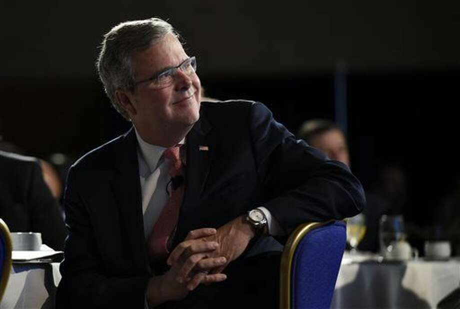 FILE - In this Nov. 20, 2014 file photo, former Florida Gov. Jeb Bush listens before speaking in Washington. More than a dozen potential Republican candidates are contemplating White House bids in 2016 in what's shaping up as a crowded and diverse field. (AP Photo/Susan Walsh, File) Photo: Susan Walsh