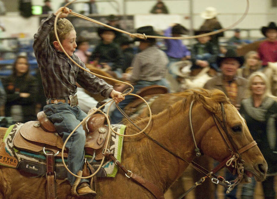 12-30-14 Tyler Lucero chases a calf Tuesday afternoon at the New Year's Calf Roping Blowout at the Horseshoe Arena. Tim Fischer\Reporter-Telegram Photo: Tim Fischer