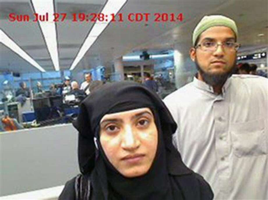 FILE - In this July 27, 2014 file photo provided by U.S. Customs and Border Protection shows Tashfeen Malik, left, and Syed Farook, as they passed through O'Hare International Airport in Chicago. A homemade bomb left behind by the husband and wife who perpetrated a mass shooting at a California social services center didn't detonate because it was poorly constructed, two law enforcement officials told The Associated Press. (U.S. Customs and Border Protection via AP, File) Photo: Uncredited