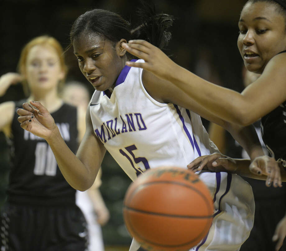 Midland High's Alexandrea Washington (15) goes after a rebound during the game against Permian on Tuesday, Jan. 26, 2016, at Chaparral Center. James Durbin/Reporter-Telegram Photo: James Durbin
