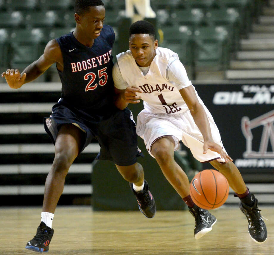 Lee High's Sema'j Davis (1) takes the ball down the court against San Antonio Roosevelt's Abideen Bello (25) during the Tall City Oilman's International tournament in this Dec. 11, 2014 photo at Chaparral Center. James Durbin/Reporter-Telegram Photo: James Durbin
