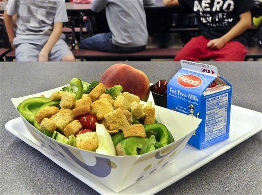FILE - This Sept. 11, 2012 file photo shows a healthy chicken salad school lunch, prepared under federal guidelines, sitting on display at the cafeteria at Draper Middle School in Rotterdam, N.Y. President Barack Obama plans to ask Congress for $12 billion over a decade to help feed schoolchildren from low-income families during the summer. (AP Photo/Hans Pennink, File) Photo: Hans Pennink