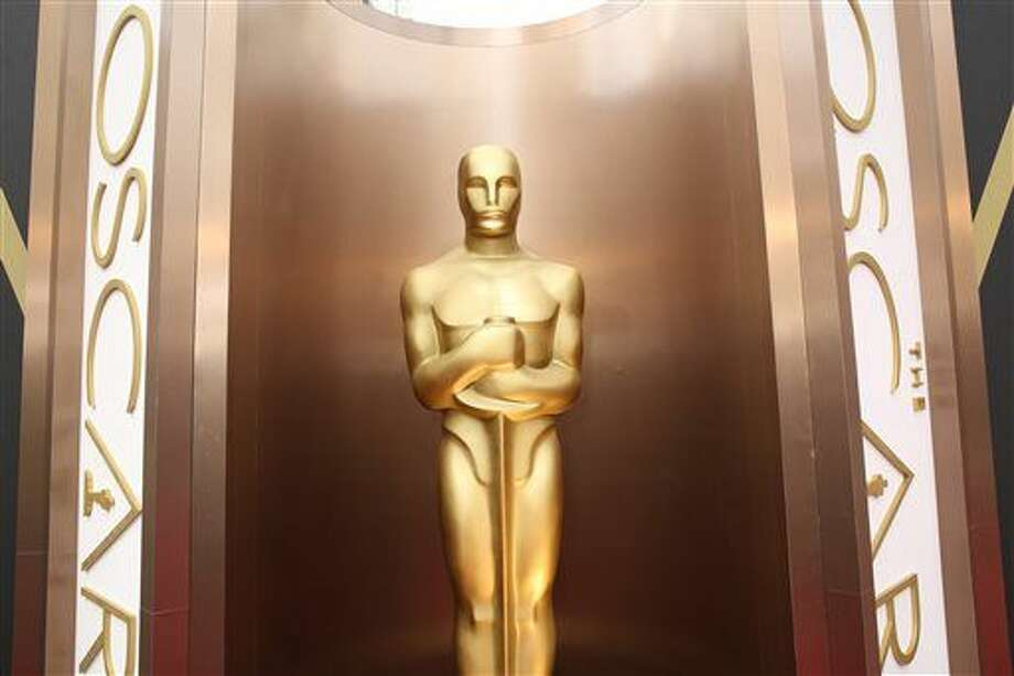 FILE - In this March 2, 2014 file photo, an Oscar statue is displayed at the Oscars at the Dolby Theatre in Los Angeles. Since the Academy of Motion Pictures Arts and Sciences said that it was altering membership rules in response to an outcry over the diversity of its voters and of its nominees, another uproar has erupted around Hollywood. Many academy members are protesting that the new measures unjustly scapegoat older academy members and imply they're racist. (Photo by Matt Sayles/Invision/AP, File) Photo: Matt Sayles