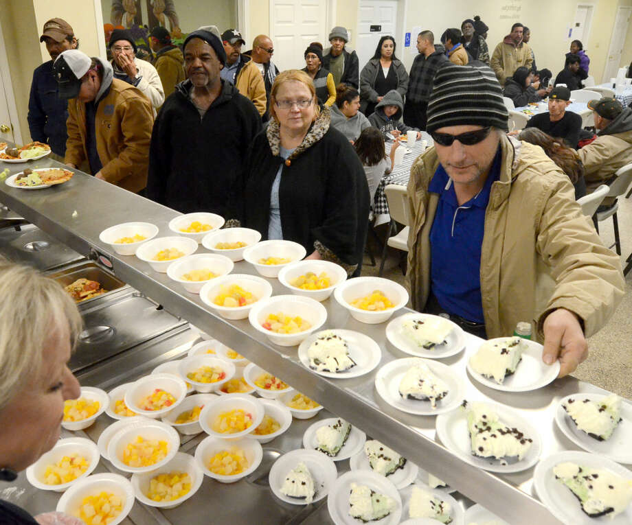 Breaking Bread serves community members in need on Wednesday, Jan. 14, 2015. Breaking Bread is raising money to expand the dining hall, kitchen and storage. James Durbin/Reporter-Telegram Photo: James Durbin