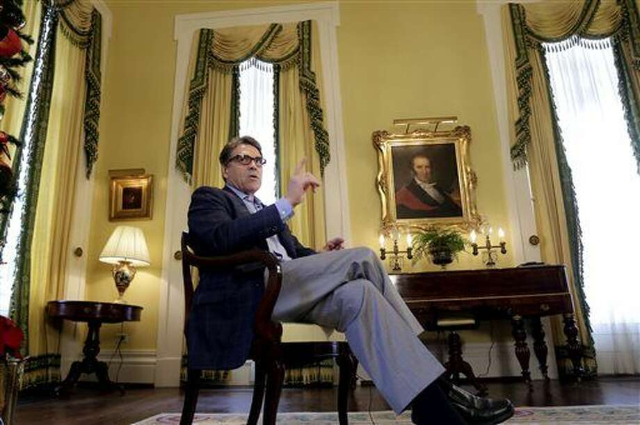 Texas Gov. Rick Perry answers questions during an interview with The Associated Press at the historic Texas Governor's Mansion, Tuesday, Dec. 9, 2014, in Austin, Texas. (AP Photo/Eric Gay) Photo: Eric Gay