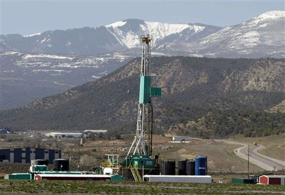 FILE - In this April 22, 2008 file photo, a natural gas well pad sits in front of the Roan Plateau near the Colorado mountain community of Rifle, Colo. Federal officials sold oil and natural gas leases on nearly 55,000 acres of federal land on the Roan Plateau but development will not occur immediately because of protests of the leases. Significant amounts of natural gas on federal lands are being wasted, costing taxpayers tens of millions of dollars each year and adding to harmful greenhouse gas emissions, a congressional investigation has found. (AP Photo/David Zalubowski, File) Photo: David Zalubowski