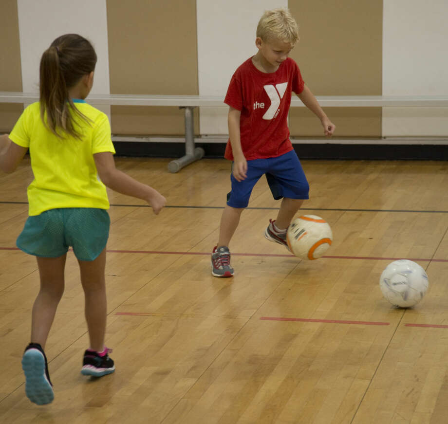 FILE - Children work on passing skills at soccer camp Tuesday 7-28-15 during sports camp at YMCA of Midland. Tim Fischer\Reporter-Telegram Photo: Tim Fischer