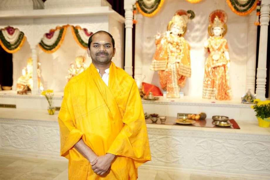 Vignesh Mahadevarahalli, priest at the Hindu Association of West Texas, poses for a portrait in the Association temple Wednesday. James Durbin/Reporter-Telegram Photo: JAMES DURBIN
