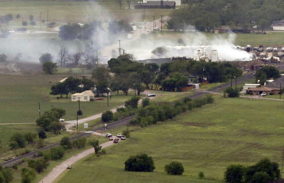 This aerial photo shows a view of homes on the North side of the fertilizer plant explosion site Thursday, April 18, 2013, in Near West, Texas. A massive explosion at the West Fertilizer Co. killed as many as 15 people and injured more than 160, officials said overnight. The explosion that struck around 8 p.m. Wednesday, sent flames shooting into the night sky and rained burning embers and debris down on shocked and frightened residents. (AP Photo/Tony Gutierrez)