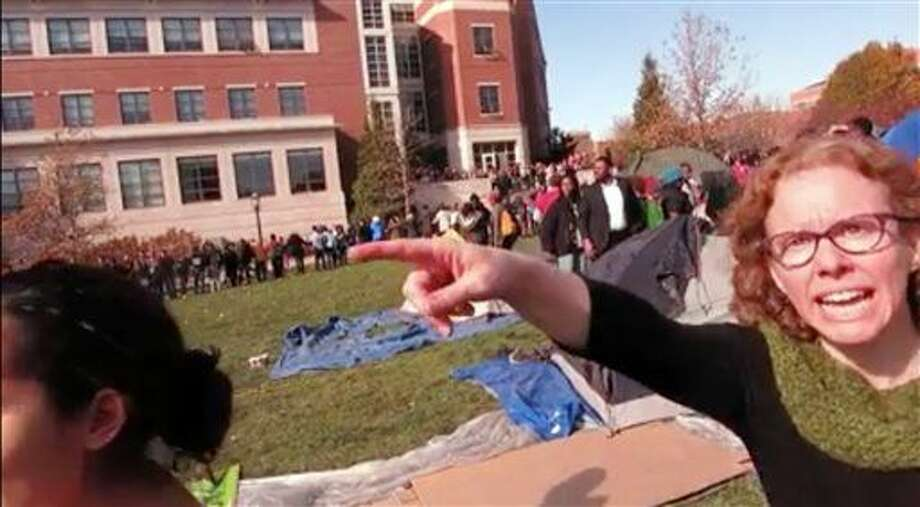 FILE - This Nov. 9, 2015 file frame grab provided by Mark Schierbecker shows Melissa Click, right, an assistant professor in the University of Missouri's communications, during a run-in with student journalists at a campus protest that followed the resignations of the university system's president and the Columbia campus' chancellor in Columbia, Mo. Click, who confronted a student photographer and another student videographer during the protests and called for 'muscle' to remove them, was charged with misdemeanor assault on Monday, Jan. 25, 2106. (Mark Schierbecker via AP, File) MANDATORY CREDIT Photo: Mark Schierbecker