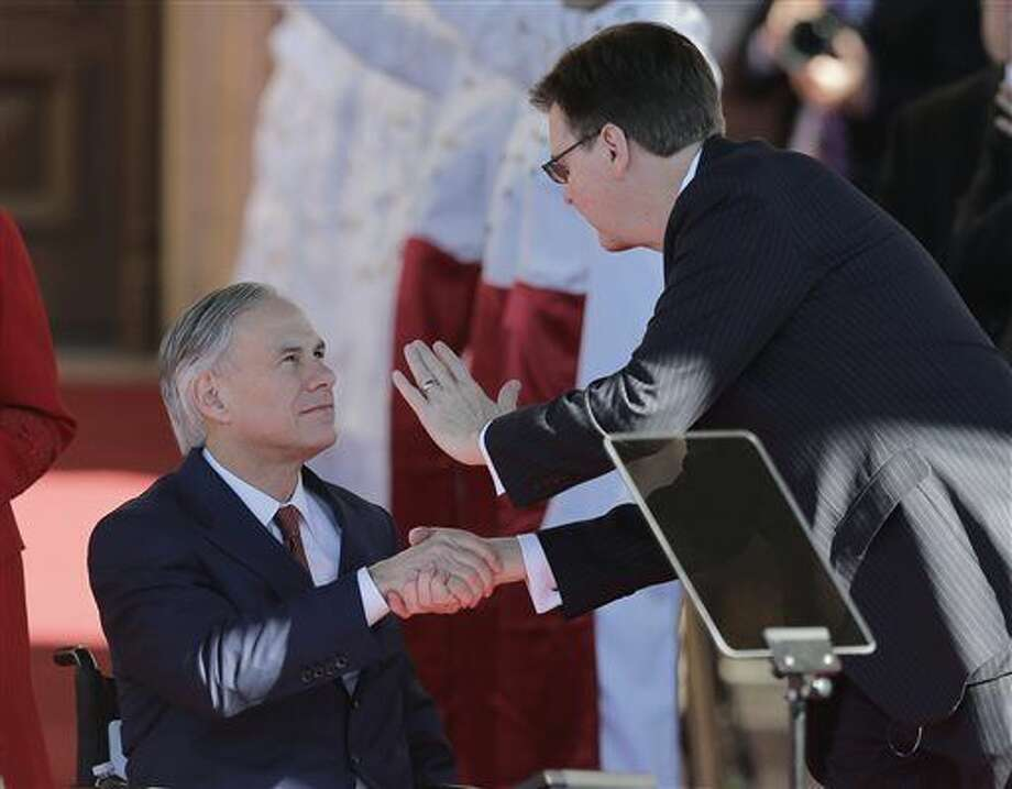 Texas Gov.-elect Greg Abbott, left, greets incoming Lt. Gov. Dan Patrick as they arrive for their inauguration, Tuesday, Jan. 20, 2015, in Austin, Texas. (AP Photo/Eric Gay) Photo: Eric Gay