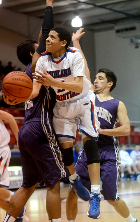 Midland Christian's Daniel Venzant (3) gets fouled by Alpine's Sunny Bhakta on Dec. 17 at McGraw Special Events Center. James Durbin/Reporter-Telegram Photo: JAMES DURBIN