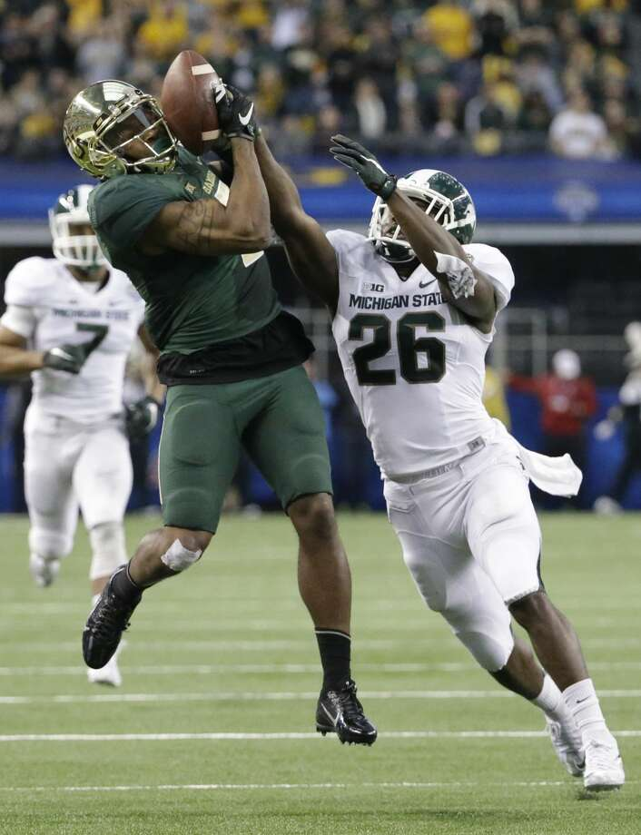 Baylor wide receiver Antwan Goodley (5) catches a pass against Michigan State safety RJ Williamson (26) during the first half of the Cotton Bowl NCAA college football game, Thursday, Jan. 1, 2015, in Arlington, Texas. (AP Photo/LM Otero) Photo: LM Otero