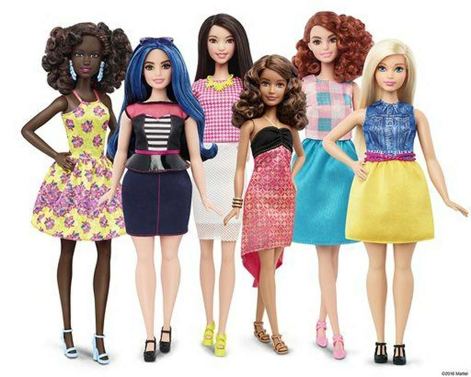 This photo provided by Mattel shows a group of new Barbie dolls introduced in January 2016. Mattel, the maker of the famous plastic doll, said it will start selling Barbie's in three new body types: tall, curvy and petite. She'll also come in seven skin tones, 22 eye colors and 24 hairstyles. (Mattel via AP) Photo: HONS