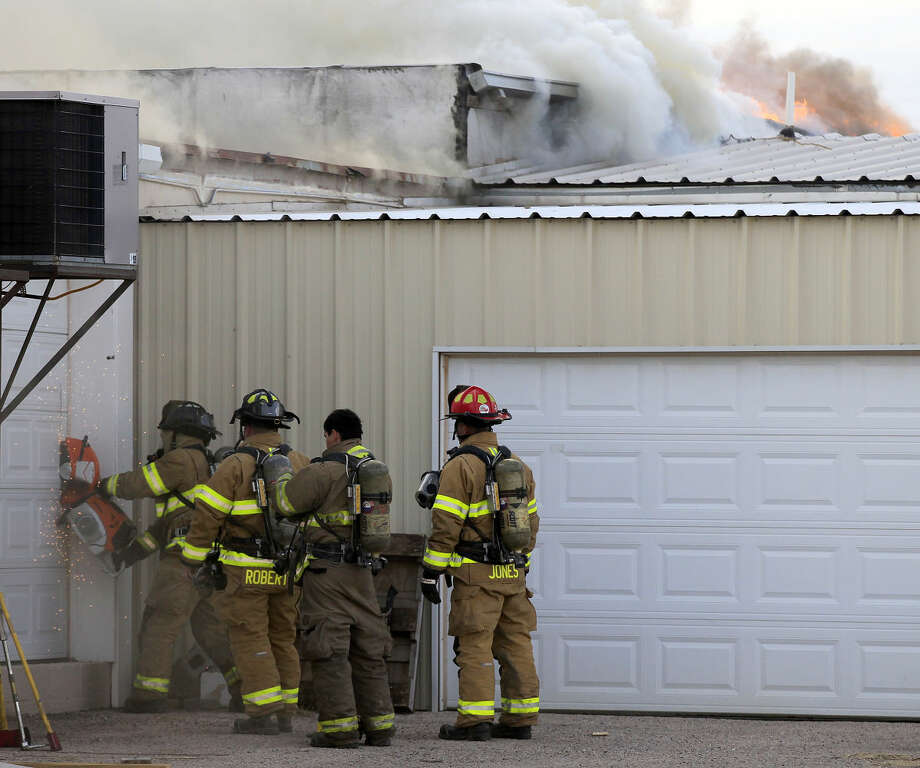 Midland emergency personnel work the scene of a fire at a storage building north of the intersection of Midkiff Road and Wall Street on Jan. 9, 2015.  Photo: James Durbin/Reporter-Telegram