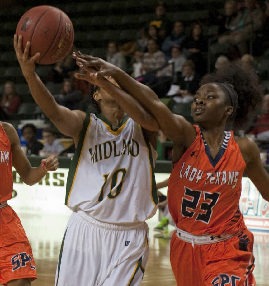 Midland College's Tanjanay Viega drives to the basket as she is fouled by South Plains' Paris Townsend Thursday, 1-22-15, at the Chaparral Center. Tim Fischer\Reporter-Telegram Photo: Tim Fischer