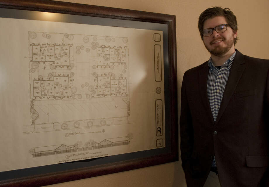 Jordan Parnell stands next to the original blue prints of Buckner homes Tuesday, 1-20-15, in his new office as executive director for Buckner Children and Family Services. Tim Fischer\Reporter-Telegram Photo: Tim Fischer
