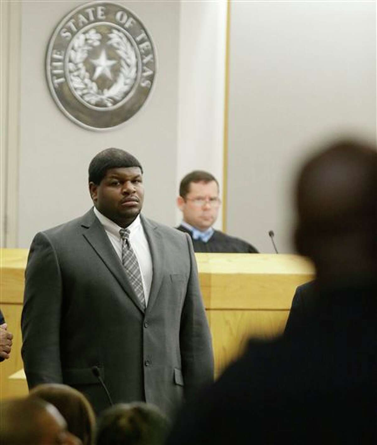 (File Photo) Former Dallas Cowboys' Josh Brent stands in court as potential jurors are directed into Judge Robert Burns, looking on in back, courtroom Friday, Jan. 10, 2014, in Dallas.