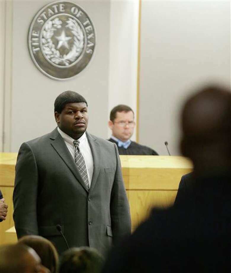 (File Photo) Former Dallas Cowboys' Josh Brent stands in court as potential jurors are directed into Judge Robert Burns, looking on in back, courtroom Friday, Jan. 10, 2014, in Dallas. Photo: LM Otero / AP