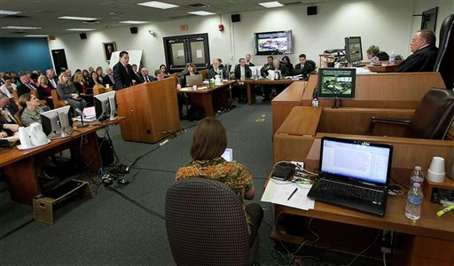 Fifteen lawyers representing six different plaintiff groups crowded one side of the Travis County courtroom of state District Judge John Dietz in October 2012 in Austin to launch the sweeping school finance trial involving about two-thirds of Texas school districts. Photo: Ralph Barrera/Associated Press / American-Statesman