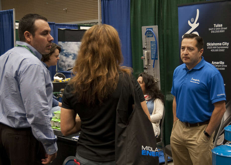 Employers talk with prospective job employees Tuesday, 4-14-15, at the Midland Energy Expo job fair at the Midland County Horseshoe. Tim Fischer\Reporter-Telegram Photo: Tim Fischer
