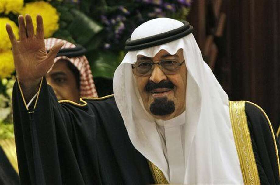 "FILE - In this Tuesday, March 24, 2009 file photo, King Abdullah bin Abdul Aziz al-Saud of Saudi Arabia, waves to members of the Saudi Shura ""consultative"" council in Riyadh, Saudi Arabia. On early Friday, Jan. 23, 2015, Saudi state TV reported King Abdullah died at the age of 90. (AP Photo/Hassan Ammar) Photo: Hassan Ammar"