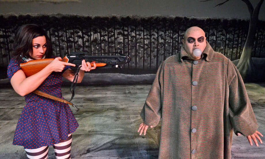 Mark Gabaldon, right, stars as Uncle Fester to Michelle Tate-Kaufman's Wednesday Addams in Midland Community Theatre's new musical 'The Addams Family.' Photo: James Durbin
