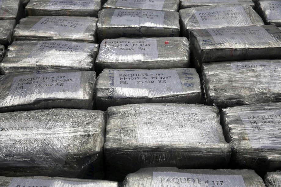 Blocks of seized cocaine are presented to the press in this unrelated AP file photo.  Photo: Associated Press