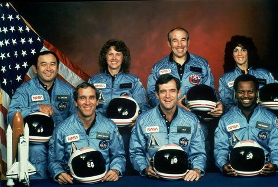 FILE - This photo provided by NASA shows the crew of the Space Shuttle Challenger mission 51L. All seven members of the crew were killed when the shuttle exploded during launch on Jan. 28, 1986. Front row from left are Michael J. Smith, Francis R. (Dick) Scobee, and Ronald E. McNair. Front row from left are Ellison Onizuka, Christa McAuliffe, Gregory Jarvis, and Judith Resnik. (NASA via AP) Photo: HOGP
