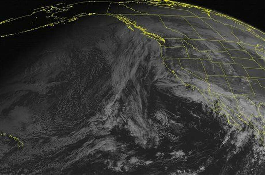 This NOAA satellite image taken Monday, January 26, 2015 at 01:00 PM EST shows a low pressure moving into the southwestern United States with rain showers. Further north, an area of high pressure over the northern and central Rocky Mountains into the central Plains with mostly sunny skies. (AP PHOTO/WEATHER UNDERGROUND) Photo: HOPD