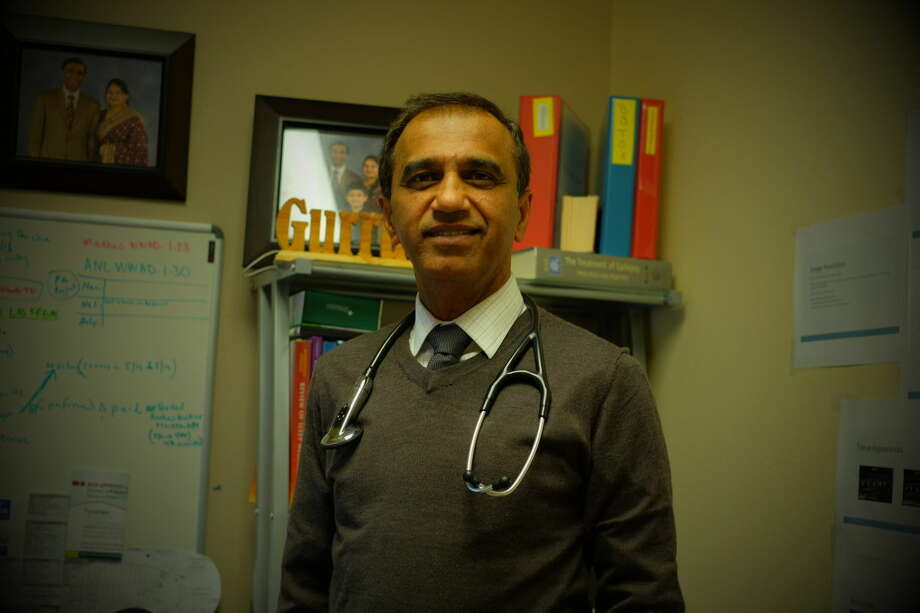 Dr. Manoher L. Gurru, neurologist for the Advanced Neuroscience Clinic and Sleep Center, stands in his office at the clinic on Andrews Hwy.