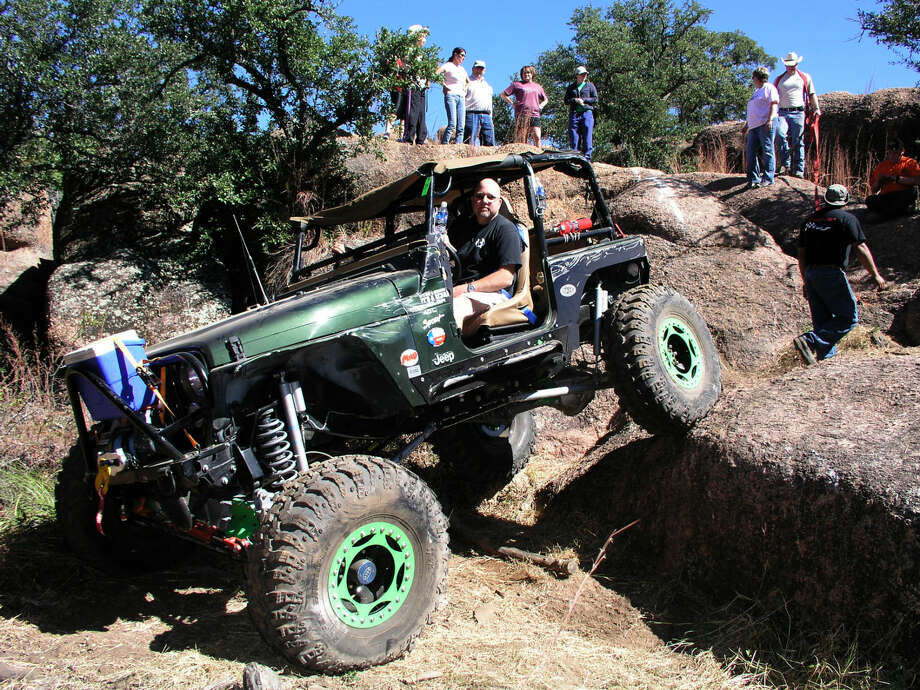 Jimmy Dalton flexes his Jeep coming down a rocky hill at the Katemcy Offroad Park. Photo by Tim Fischer